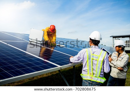 Technician team Repair and maintenance of solar panel #702808675
