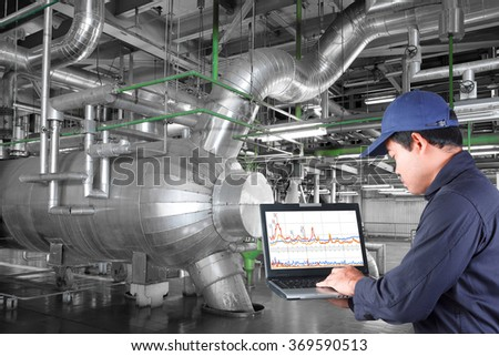 Technician use computer check for maintenance equipment and pipeline in a modern thermal power plant industrial
