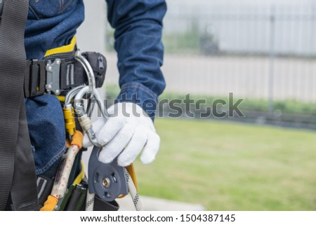 Technician Wear seat belts Safety harness Going up the stairs fixed ladder Working on a high ground In industrial plants prevent Fall from a height Wear protective equipment With space to enter text stock photo