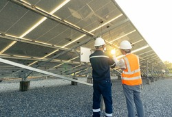 Technician with engineer are check the performance of the solar panels in the solar plant, Alternative energy to conserve the world's energy, Photovoltaic module idea for clean energy production.