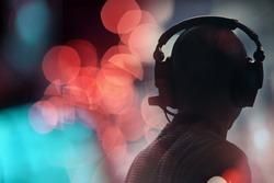 Technician with headphones on his head
