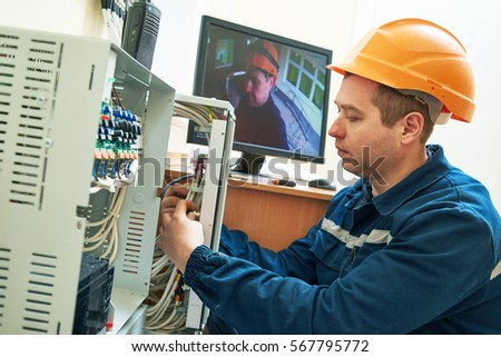 Technician worker adjusting video surveillance system #567795772