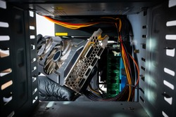 technician worker installing gpu graphics card to a desktop pc case. looking inside pc case. hardware assembling. appliance repair service concept.