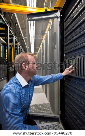 Technician working on a large scale Storage server