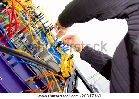 Technician working on server rack