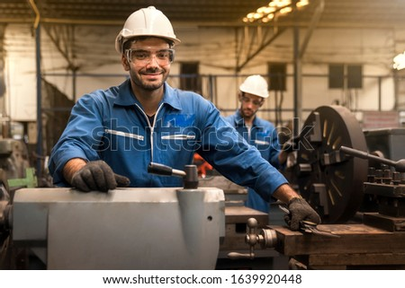 Technicians and engineers are working in a factory with modern machines. Twins Caucasian man Mechanical Engineer checking equipment in the industrial.