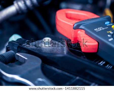Technicians are providing electrical and engine inspection services to customer who come to service in the car service center. #1411882115