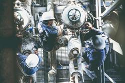 Technicians perform calibration operations, flow gauges, control valves that operate.