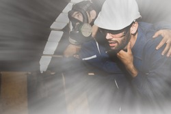 Technicians wear NH3 ammonia protective masks to help colleagues suffocate urgently due to the severe pungent ammonia gas leak in industrial work areas.