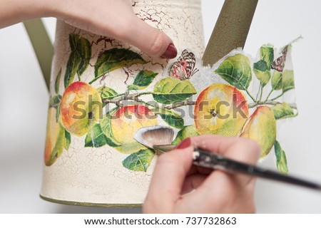 technique decoupage. decorating objects with paper napkins with a pattern. A ready-made drawing is used and an appliqué is made.