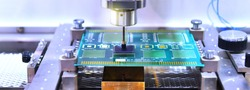 Technological process of soldering and assembly chip components on pcb board. Automated soldering machine inside at industrial, banner side