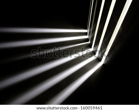 Technology abstract -- white light beams from a hidden source in the dark