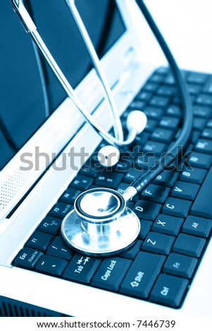 Technology and medicine - Silver stethoscope over laptop keyboard
