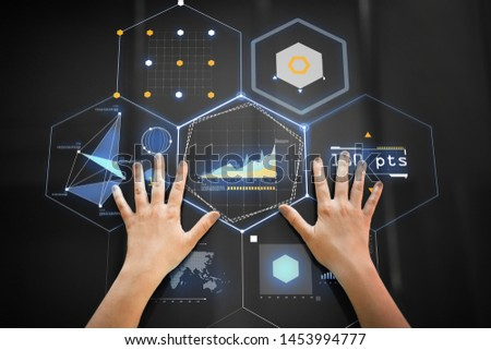 technology and people concept - hand using black interactive panel with virtual projections of charts