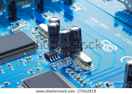 Technology: capacitors and chips on blue microcircuit board