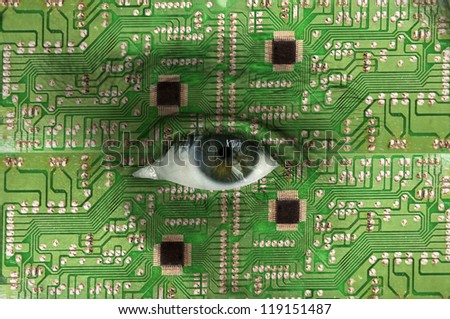Technology concept - human face with open eye covered with electronic circuit texture