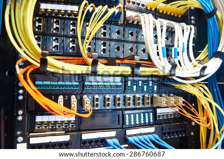 technology equipment with optical fibre cables connected to rack servers in room #286760687