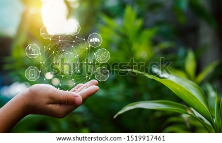 Technology, hand holding with environment Icons over the Network connection on green background.  Stockfoto ©