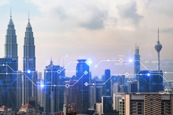 Technology hologram over panorama city view of Kuala Lumpur. KL is the largest tech hub in Malaysia, Asia. The concept of developing coding and high-tech science. Double exposure.