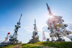 Technology on the GSM telecommunications tower 5G. Cell phone antennas at the top of the mountain. Receiving and transmitting stations.