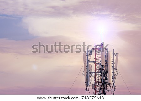 Technology on the top of the telecommunication GSM (5G,4G,3G) tower.Cellular phone antennas on a building roof.silhouette of Telecommunication mast television antennas. #718275613