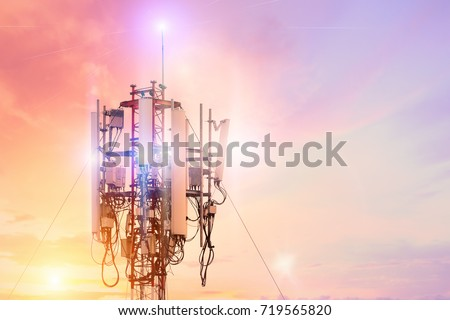 Technology on the top of the telecommunication GSM (5G,4G,3G) tower.Cellular phone antennas on a building roof.Telecommunication mast television antennas.Receiving and transmitting stations. #719565820