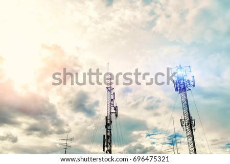 Technology on the top of the telecommunication GSM (4G,3G) tower.Cellular phone antennas on a building roof.silhouette of Telecommunication mast television antennas.