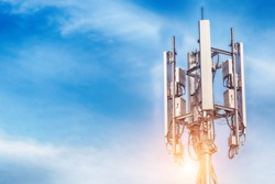 Technology on the top of the telecommunication GSM (5G,4G) tower with copy space.Cellular phone antennas on a building roof.Telecommunication mast television antennas.Development communication system