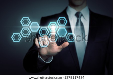 technology, science, business concept - businessman in suit presses virtual touchscreen interface button - abstract hexagonal scientific structure