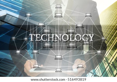 Technology Text and Distributed computer network with Businessman holding the tablet over the Modern business building glass of skyscrapers, Distributed ledger technology and block chain concept