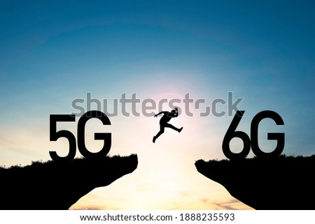 Technology transformation change  from 5G to 6G , Silhouette businessman jumping from 5G cliff to 6G cliff on blue sky.