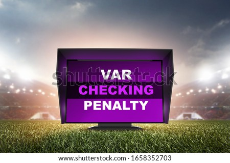 technology var checking penalty.The video assistant referee scene a match official in football stadium.  Imagine de stoc ©