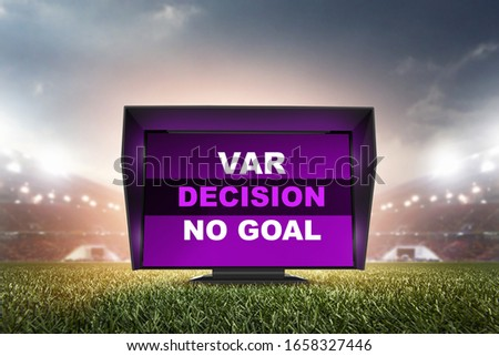 technology var decision no goal.The video assistant referee scene a match official in football stadium. Imagine de stoc ©