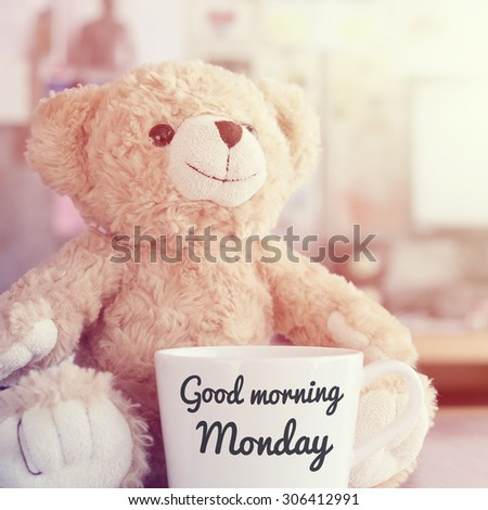 Teddy bear and coffee cup,focused on teddy bear face in Blurred background with vintage filter