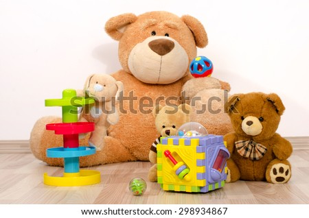 Teddy bear having fun. Many bear toys playing, one big bear watching his little bears playing with balls and boxes
