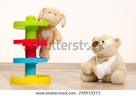 Teddy bear having fun. Two bear toy playing, one with a broken hand wrapped in bandages.