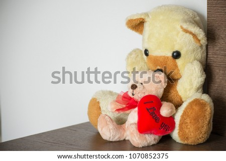 teddy bear holding a red heart #1070852375