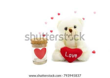 Teddy bear holding red heart and glass heart bottle. On a white background with a red and pink heart. Valentine's Day Concept Valentines Day Cards #793945837