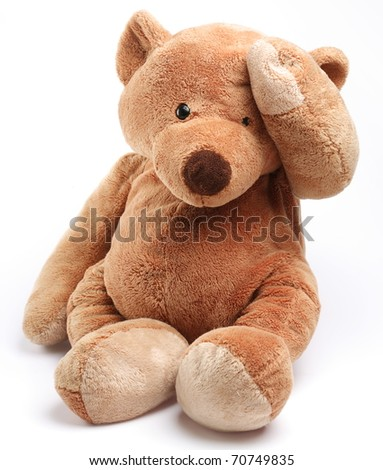 Teddy bear in a worry. Isolated over white.