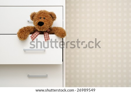 Teddy bear in dresser
