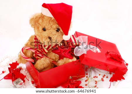 teddy bear in santa`s  hat as christmas gift in red box