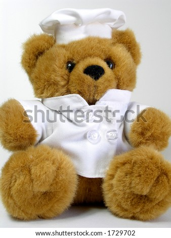 Teddy bear is wearing a chef's dressing.