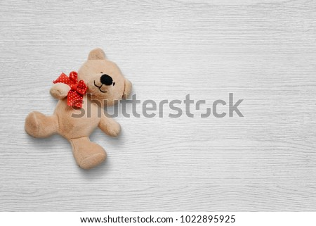 Teddy bear on white wooden deskt with free space for text. #1022895925