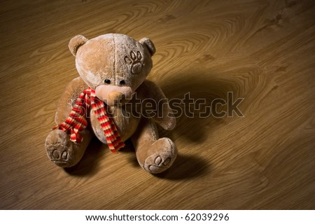 Teddy bear on wood floor