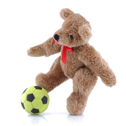 Teddy bear playing football soccer on white background