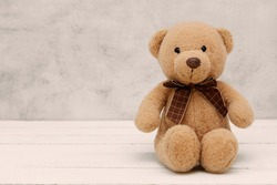 Teddy Bear soft toy on grey background, isolated. Education, parenting and childhood baby concept. Copy space for text.