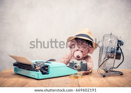 72a49e26b0547 Teddy Bear toy in hat sitting at the old wooden desk with mint green retro  typewriter