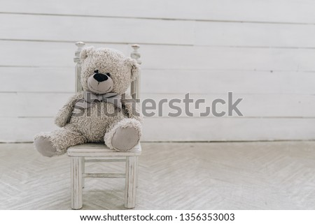 Teddy bear toy on a small toy chair