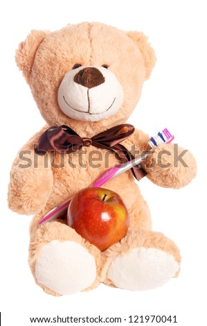Teddy bear with apple and toothbrush