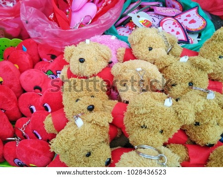 Teddy bear with red flower in the heart of Valentine's Day #1028436523